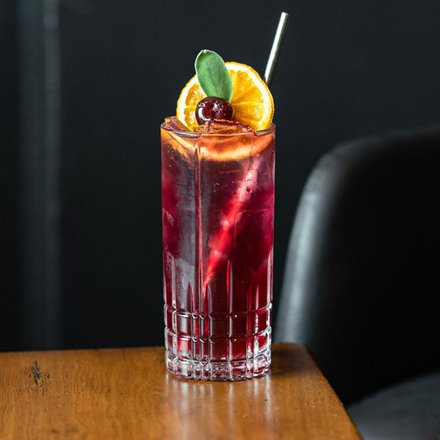 🏔️ R O C K Y  M T N  C O L L I N S 🏔️ INGREDIENTS: 1.5oz Dry Town Gin 1oz Cherry Syrup 0.5oz Lime Juice Two Dashes of Angostura Bitters  METHOD: Combine all ingredients in a cocktail shaker and shake with ice. Strain into a Collins glass over fresh ice and top with soda water. Garnish with a Luxardo cherry, fresh sage leaf and an orange wheel.