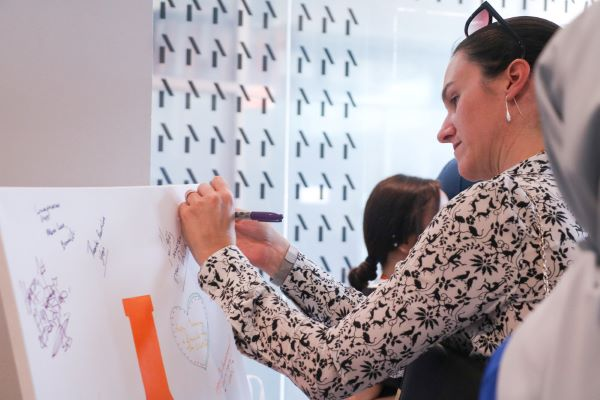 The Australian High Commissioner, Nicola Rosenblum, leaving a message on our canvas.