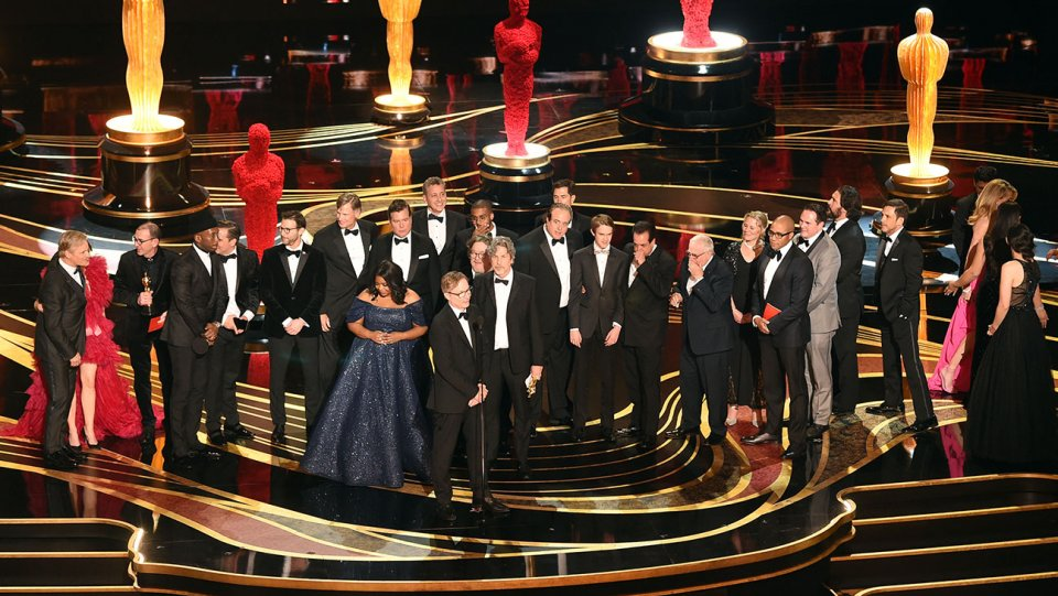 Cast and crew of Green Book onstage at the Awards.