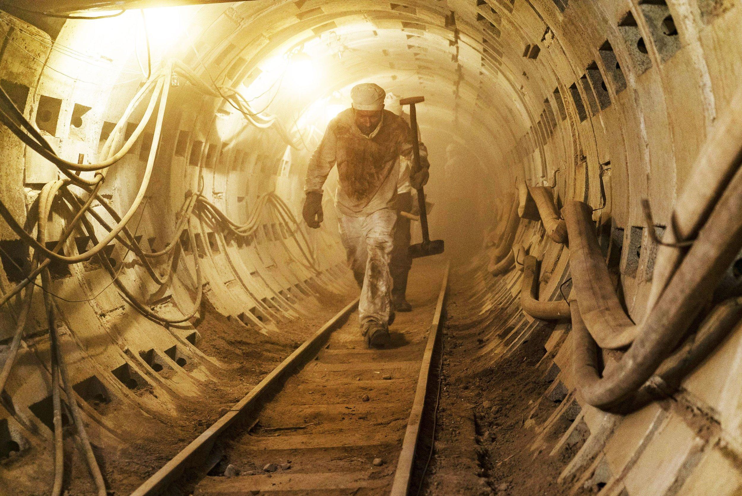 Miners working beneath the reactor.