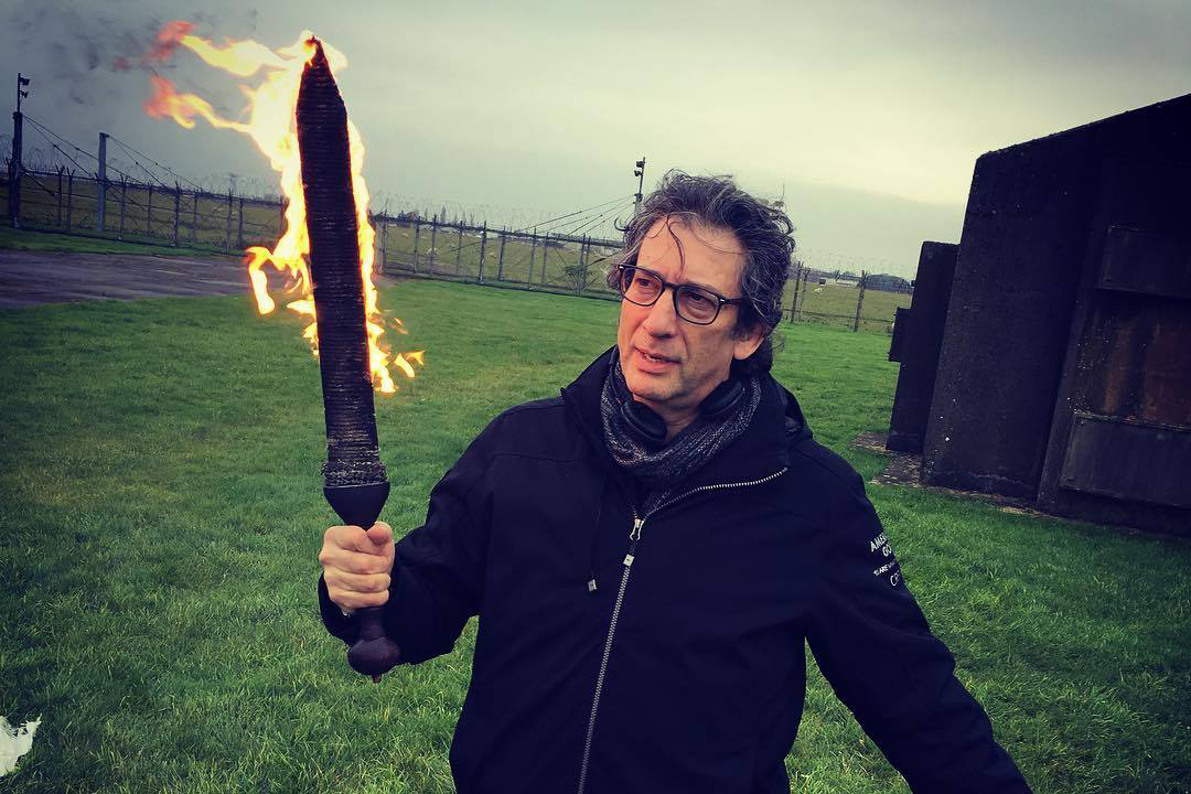 Gaiman on set playing with a flaming sword. When he tweeted out this picture I might have let out a gleeful squeal.