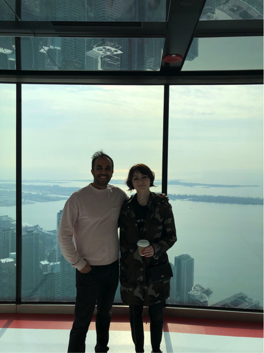 Drinking coffee on top of the world. Those are skyscrapers below us!