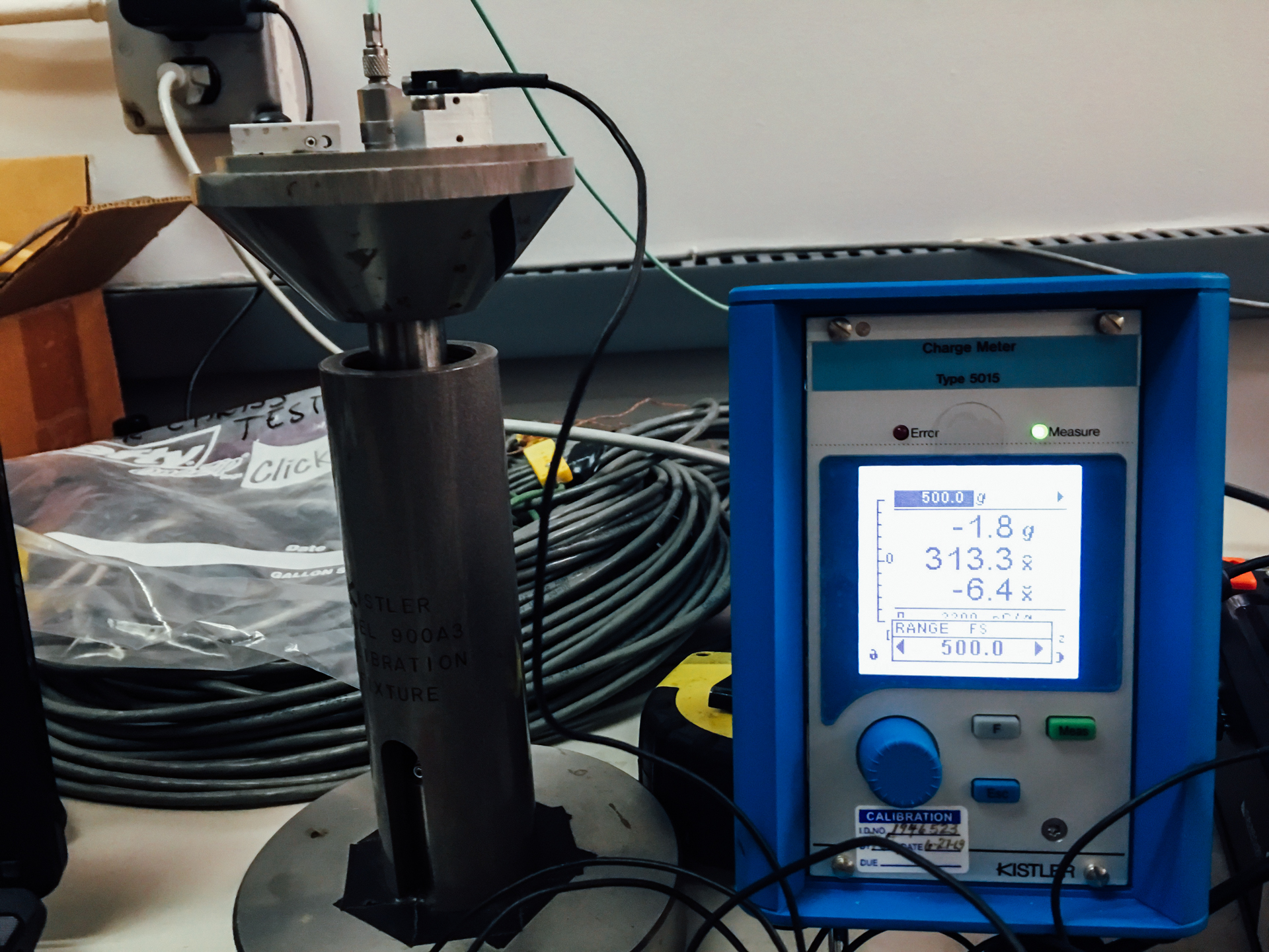 Figure 3a: A Kistler calibration drop tower (Model 5015) with a peak G display screen