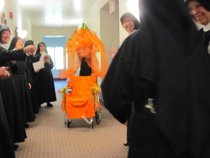 Sisters sing Jubilee song for Sr. Mary Dolores as her Pumpkin Carriage appears