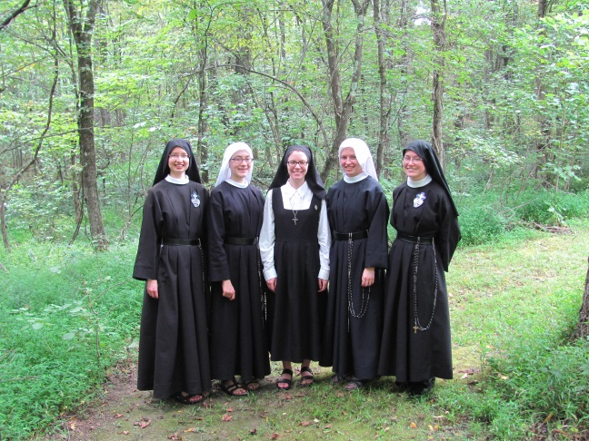 I don't have many pictures of Sr. Maria Faustina as a nun but here she is in the center of a group photo last summer. Ahh...soon we will see green in the woods once again. :)