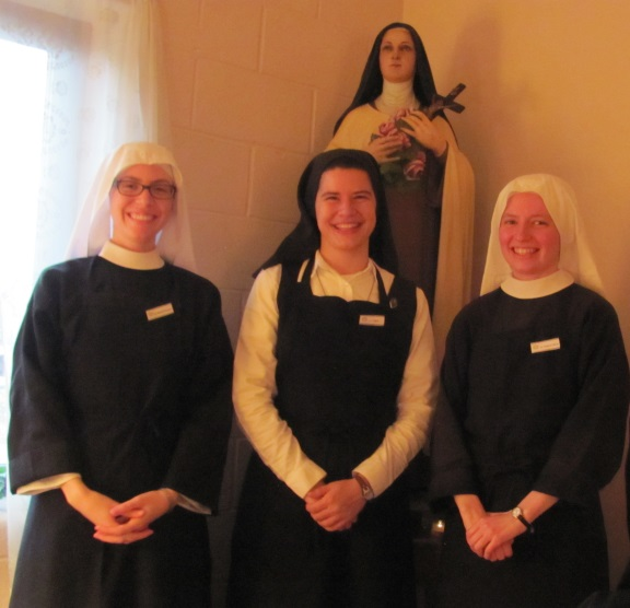 """The 3 """"waitresses"""" pose with their aprons and name tags"""