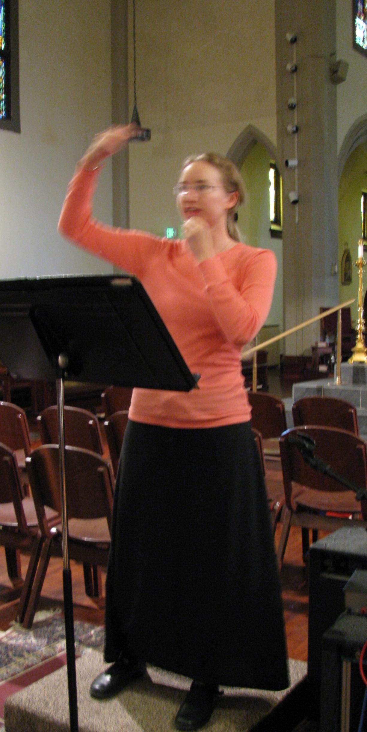 Conducting the choirs at Assumption Parish.