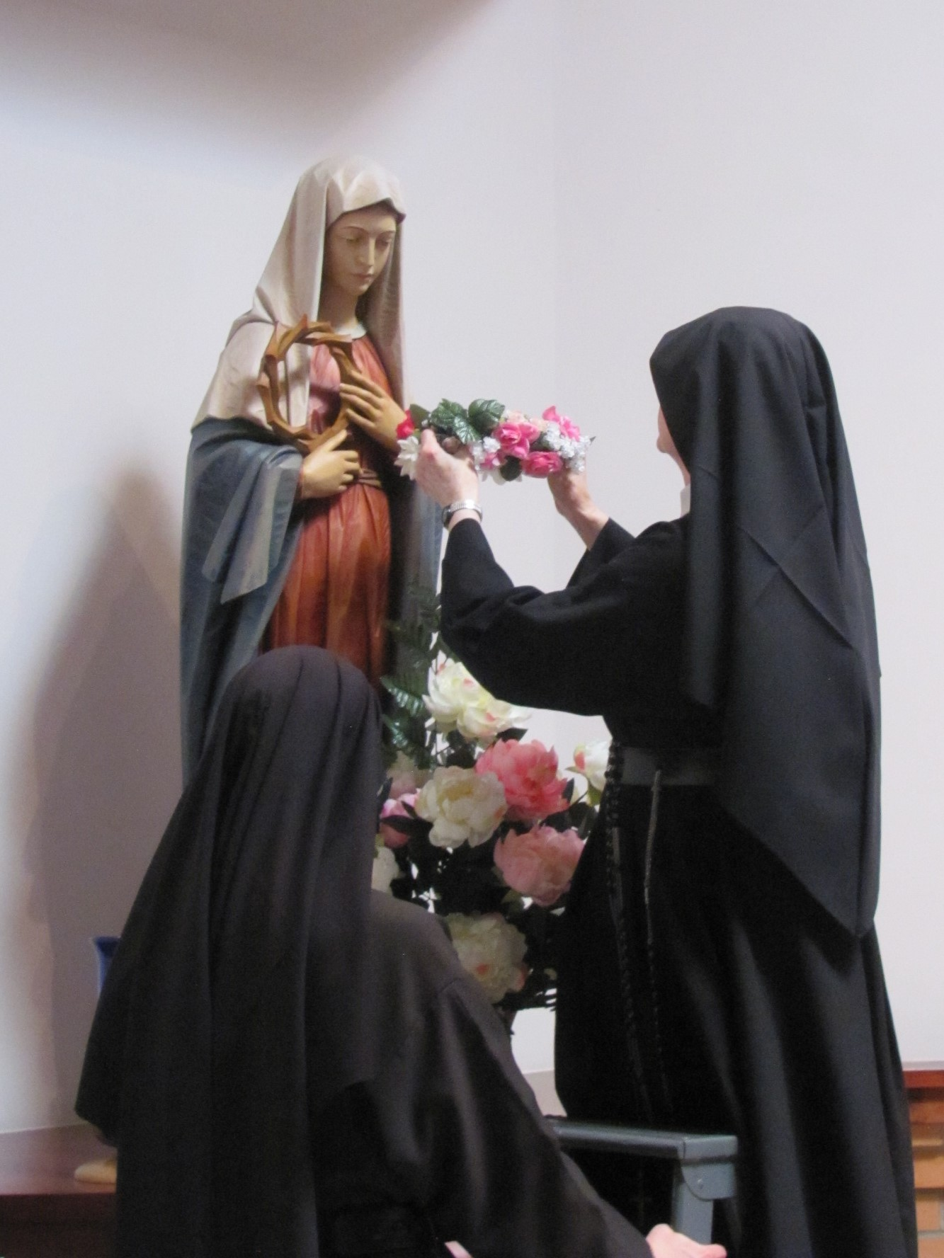 Sister Catherine Marie crowns our Blessed Mother in the back of the chapel