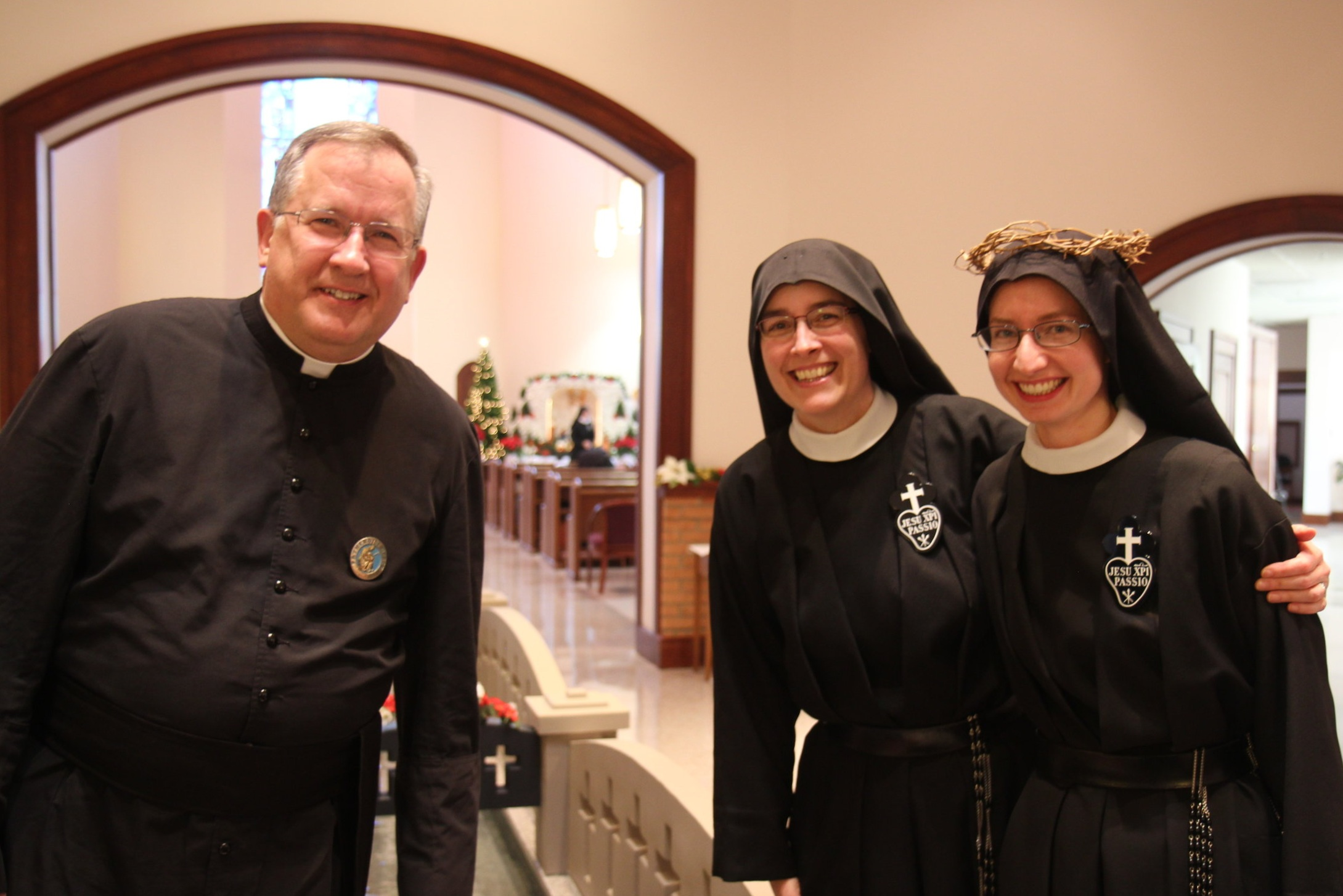 Fr. David Wilton, CPM, Mother John Mary, and Sr. Cecilia Maria after the Mass