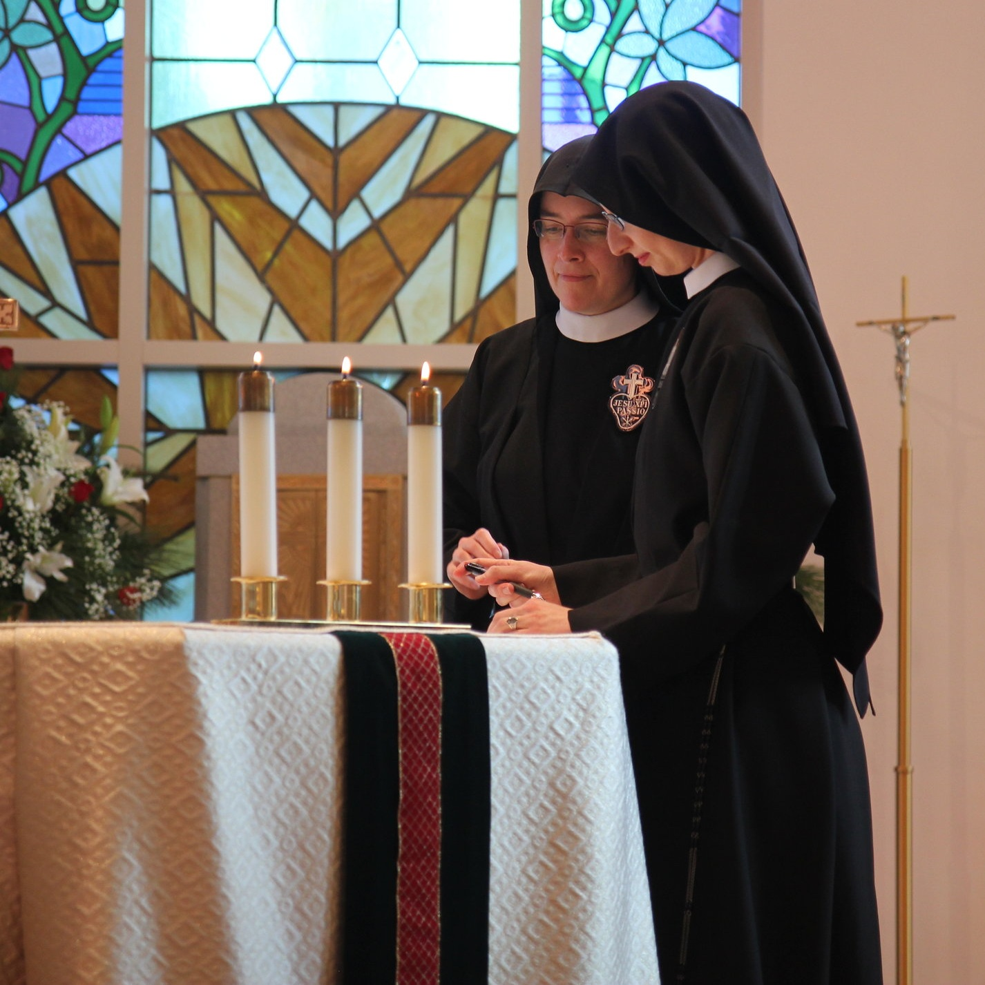 Sr. Cecilia Maria signs the profession formula which remains on the altar for the rest of the Mass, signifying her oblation of self in union with Jesus' Eucharistic Sacrifice.