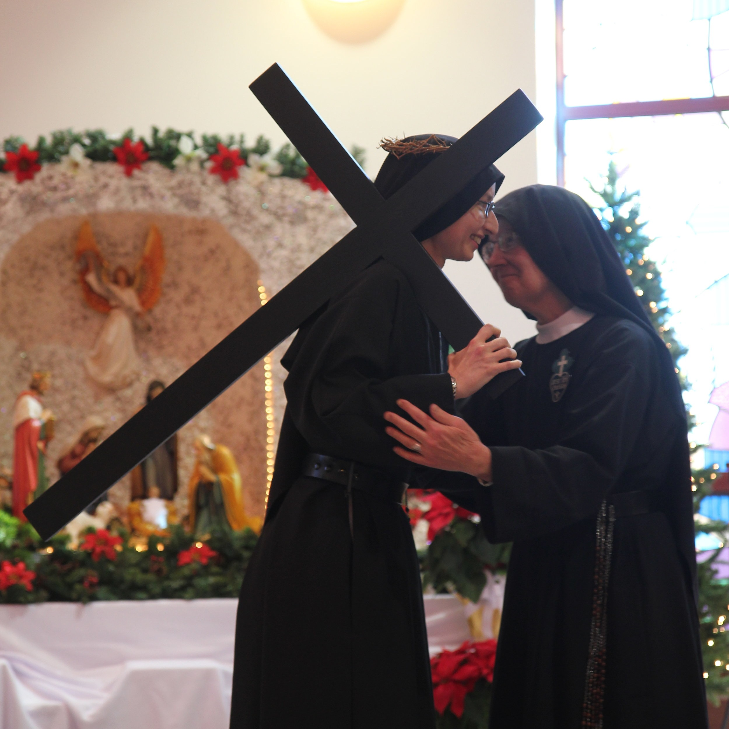 Sr. Mary Veronica, Novice Mistress and Juniorate Directress, exchanges the sign of peace with her spiritual daughter
