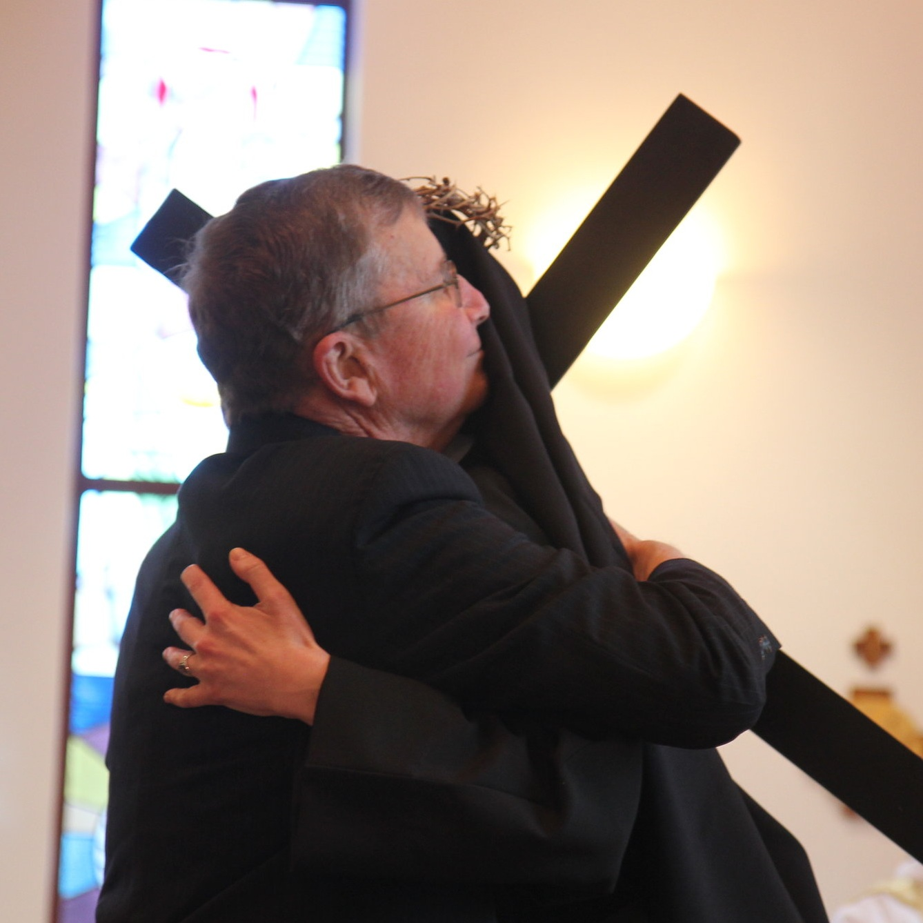 A father's embrace - Sr. Cecilia Maria and her dad, Tim, exchange a sign of peace.