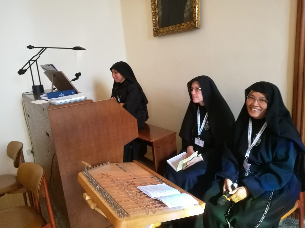 General Chapter members preparing for daily Mass - besides the organ, some of the nuns played a lovely type of auto-harp.