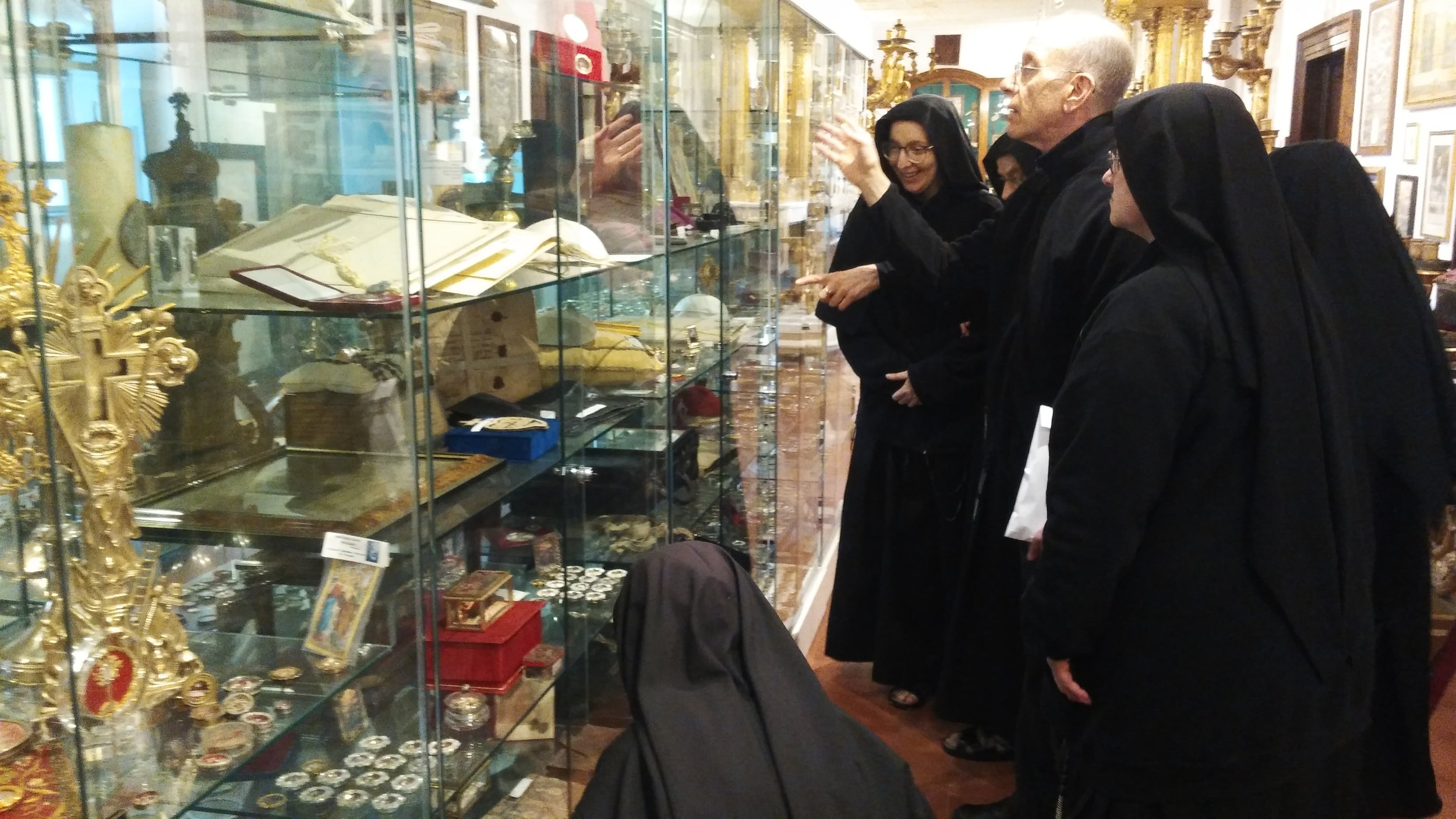 Fr. Lawrence gives some of the nuns a tour of the museum at Sts. John & Paul Passionist Generalate in Rome.  So many relics and antique religious items!
