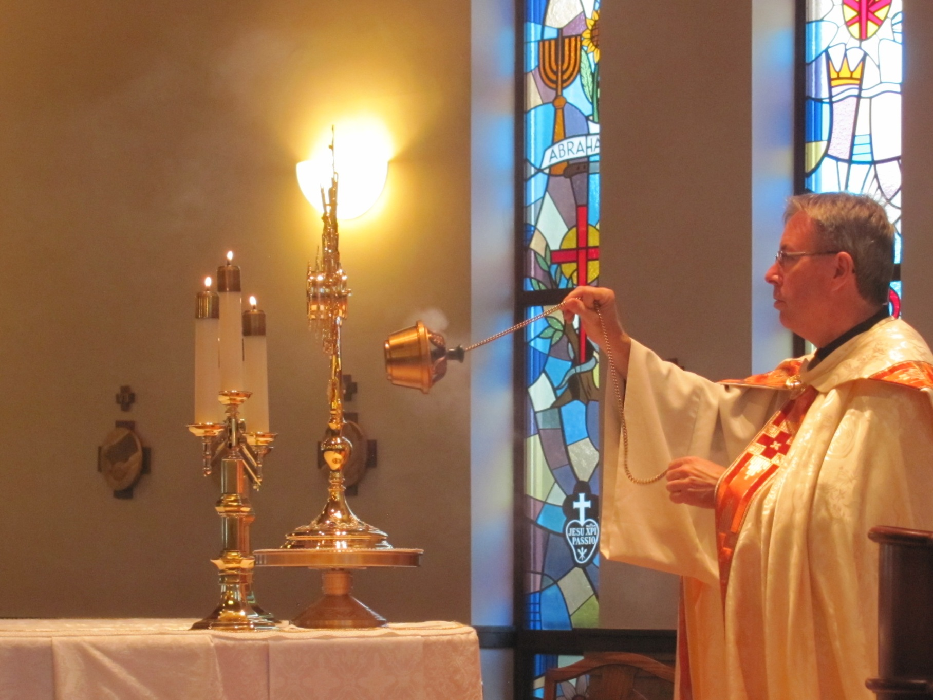 Fr. David Colhour, CP, incenses the Blessed Sacrament during 40 Hours