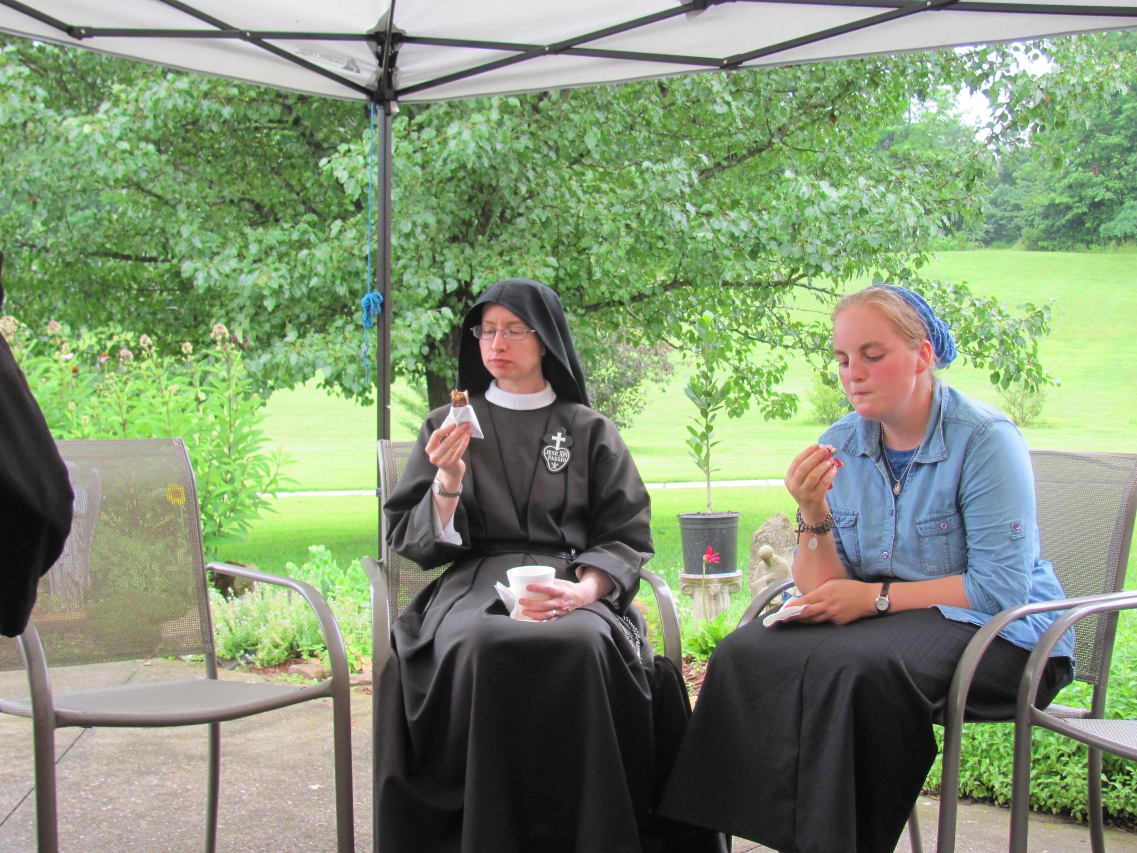 Sr. Cecilia Maria and Abbey deep in ice cream contemplation.