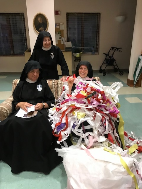 Sr. Frances Marie triumphantly displays the found ring as Sr. Mary Therese and Sr. Mary Elizabeth look on.