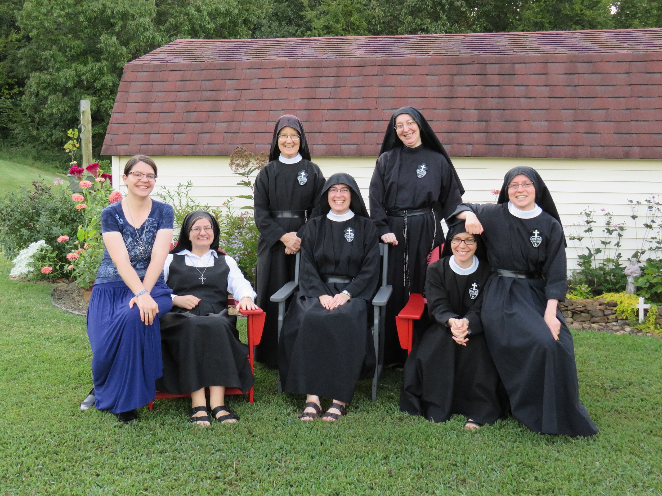 A (mostly) normal photo - aspirant Kathryn, postulant Theresa, Sr. Mary Veronica, Mother John Mary, Sr. Daniela, Sr. Maria Faustina the Long-Suffering Arm Rest, and Sr. Frances Marie.