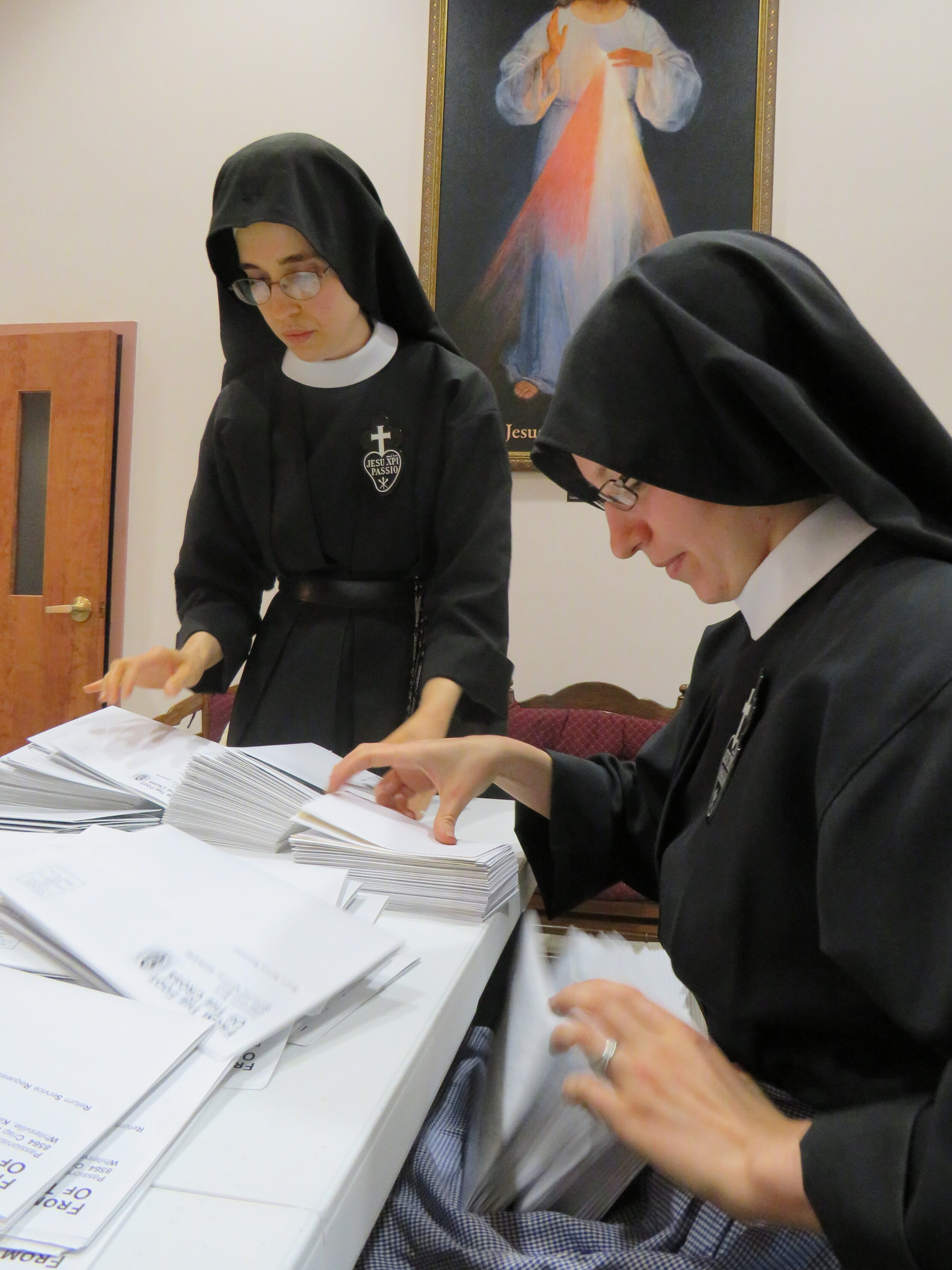 Sr. Mary Andrea and Sr. Frances Marie hard at work filling newsletters