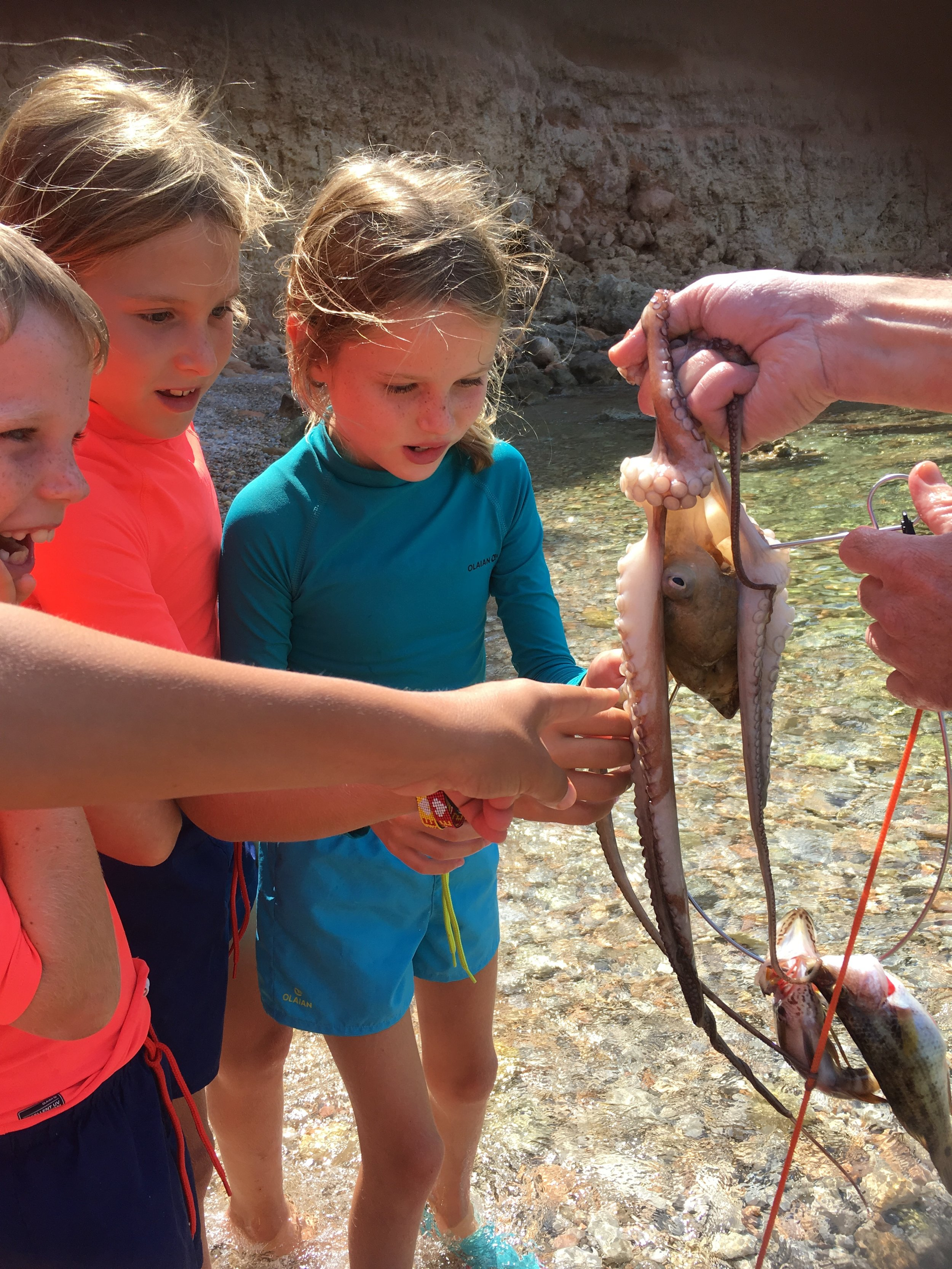 We strongly encourage interacting with nature. We'll be doing our best to catch and release wildlife. Here some spear fisherman showed us some of their catch.