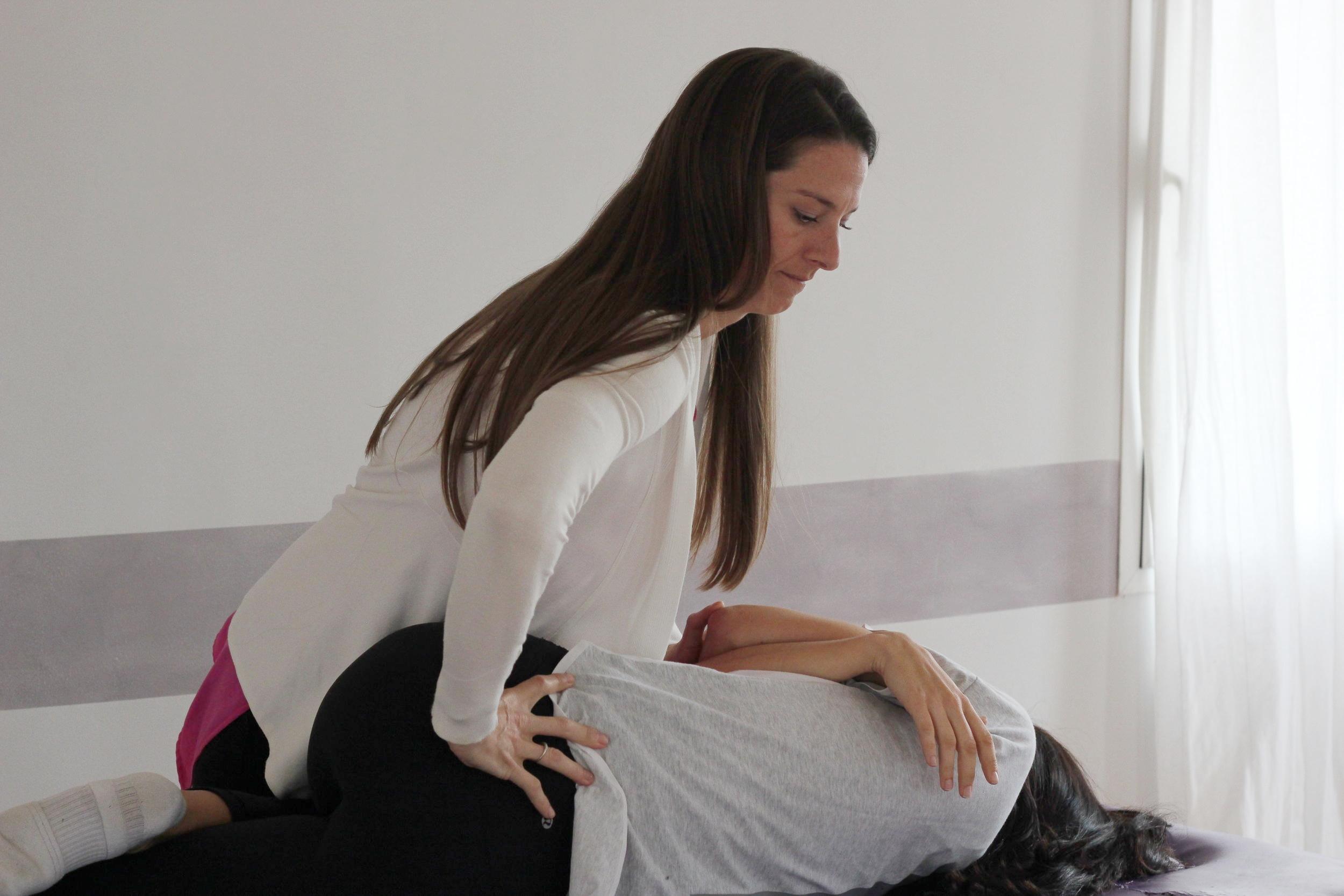 Dr. Julie giving a low back adjustment