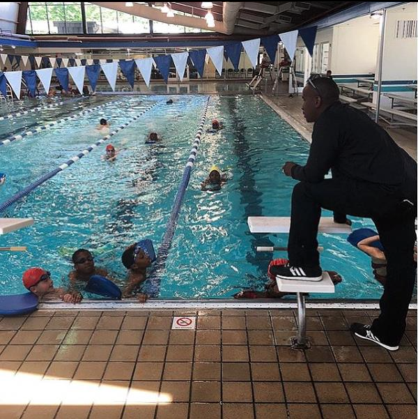 Coach Tarus Nelson instructing the youth on swimming techniques in preparation for a Splash N Dash.    Photo Credit:     Charlese     Bowman