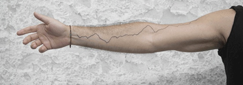 """photo+sphere  presenter Justin Guarigila's tattoo tracks the global temperature rise from 1880-2016 and was a performance art piece """"commemorating the news that we've officially entered the Anthropocene."""""""