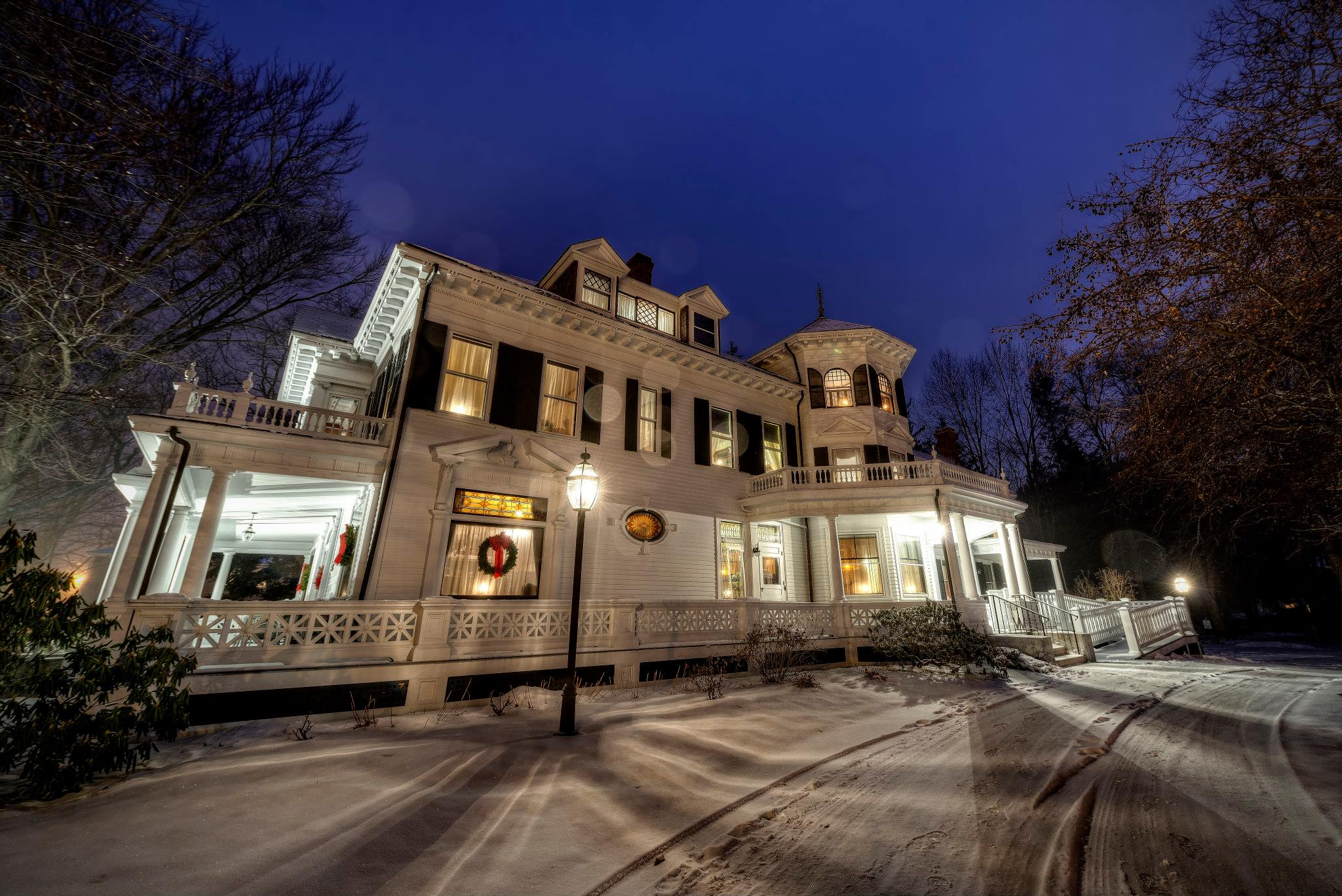 Exterior shot of the Murdock Whitney House at night