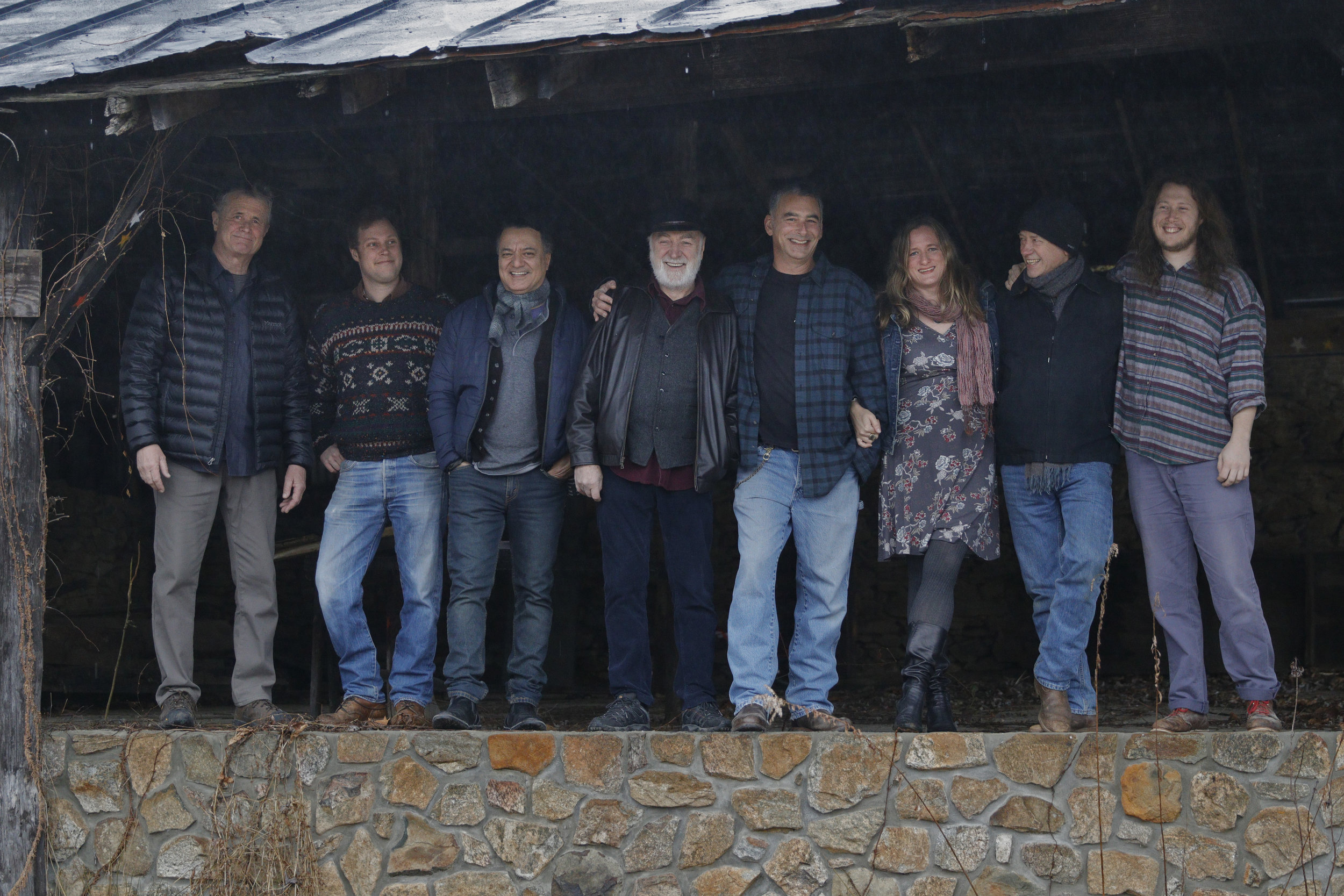 "L to R: Terry Waggener (bass), Jonathan Marquisee (dobro, banjo), Shahin Shahida (guitar, vocals), Robert ""Smiggy"" Smith (guitar, Wurlitzer, vocals), Drew Smith (drum, cymbals, percussion, vocals), Miranda Hope (guitar, vocals), Vincent Day (guitar, ukulele, mandolin, vocals), and Forrest Marquisee (guitar, pedal steel, vocals). Also, not shown: Frank Austin (guitar, vocals), Vincent Henry (clarinet, bass clarinet), and Mack Stacks (producer, bass, percussion, vocals)."