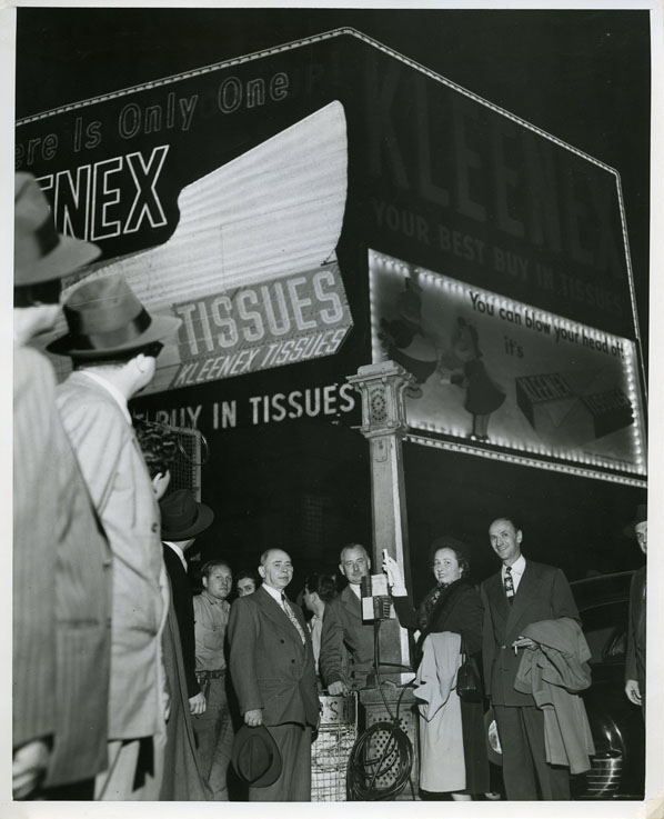 Marge participated in the publicity for the first giant neon billboard advertising Kleenex and featuring Lulu, in 1949. Here she plugs in the lights for the billboard, made by Artkraft Strauss, on  October 20, 1949