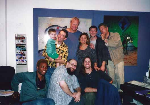 At a recording session: (bottom, left to right) Krandal Crews, recording engineer; Sherm Cohen, director; Justin Brinsfield, assistant recording engineer. Top, left to right: Mack Kenny; Tom Kenny, voice of SpongeBob; Bill Fagerbakke, voice of Patrick; Jennie Monica Hammond, casting supervisor; Derek Drymon, creative director; and Clancy Brown, voice of Mr. Krabs.
