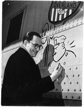 Jay Irving, sketching on a Union Pacific railroad car.