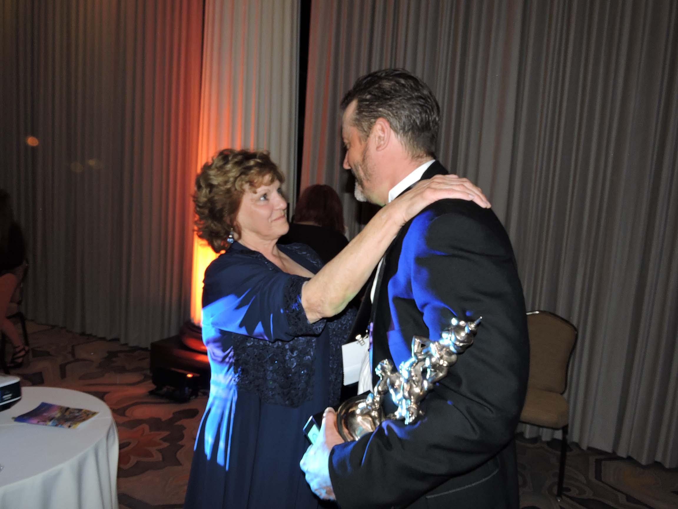 Betty Evans congratulates Stephan Pastis...