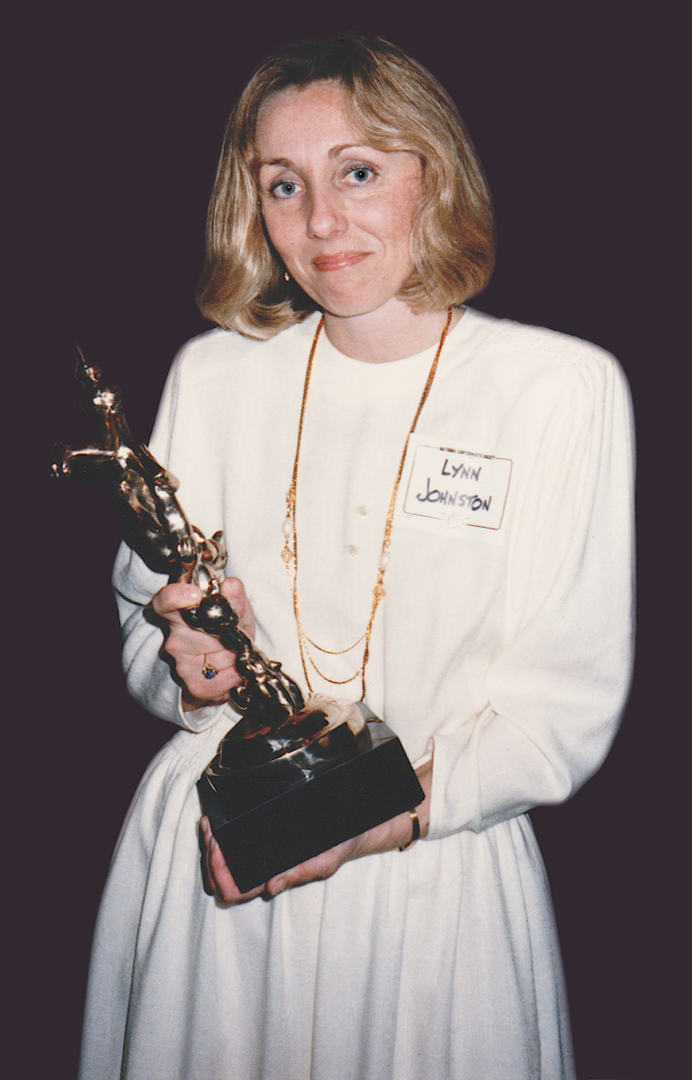 Lynn with her first Reuben Award, in 1986. She was the first woman (and the first Canadian) to win the Reuben Award, given by the National Cartoonists Society to the top cartoonist of the year.