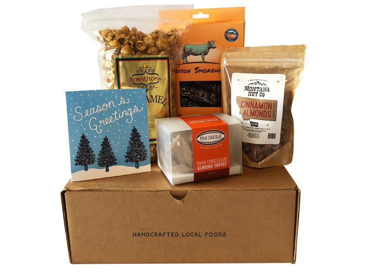 The Happy Holidays gift box includes dark chocolate toffee, caramel corn, beef jerky, cinnamon almonds, and a hand-printed holiday card.