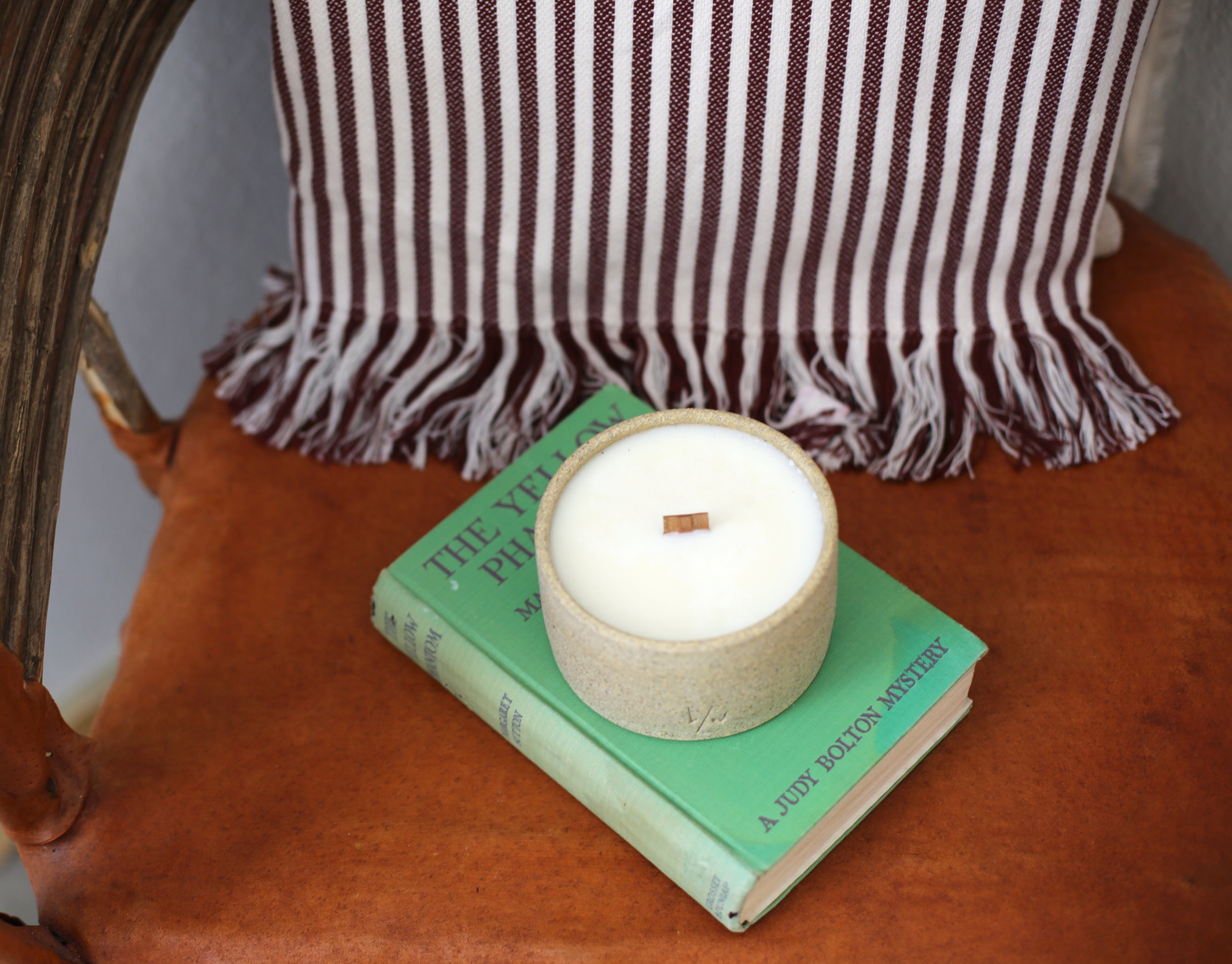 Candle And Green Book In Corner Chair 4.jpg