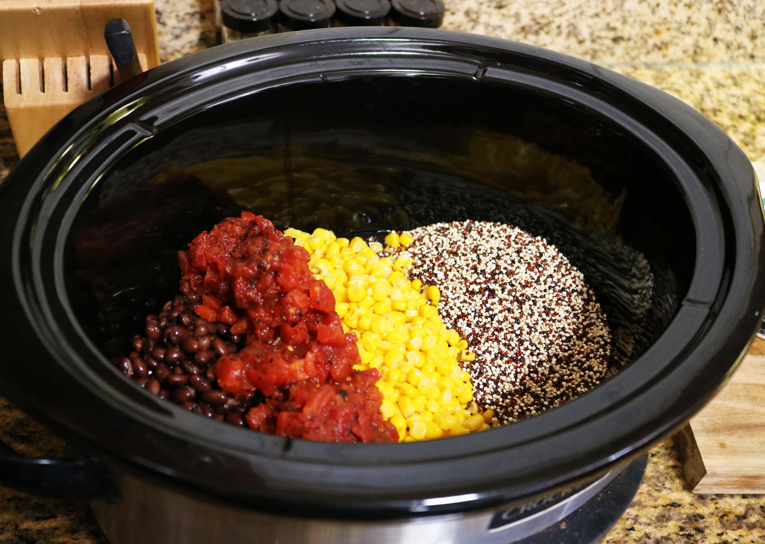 Add beans, corn, diced fire roasted tomatoes and green chiles, quinoa, and water.