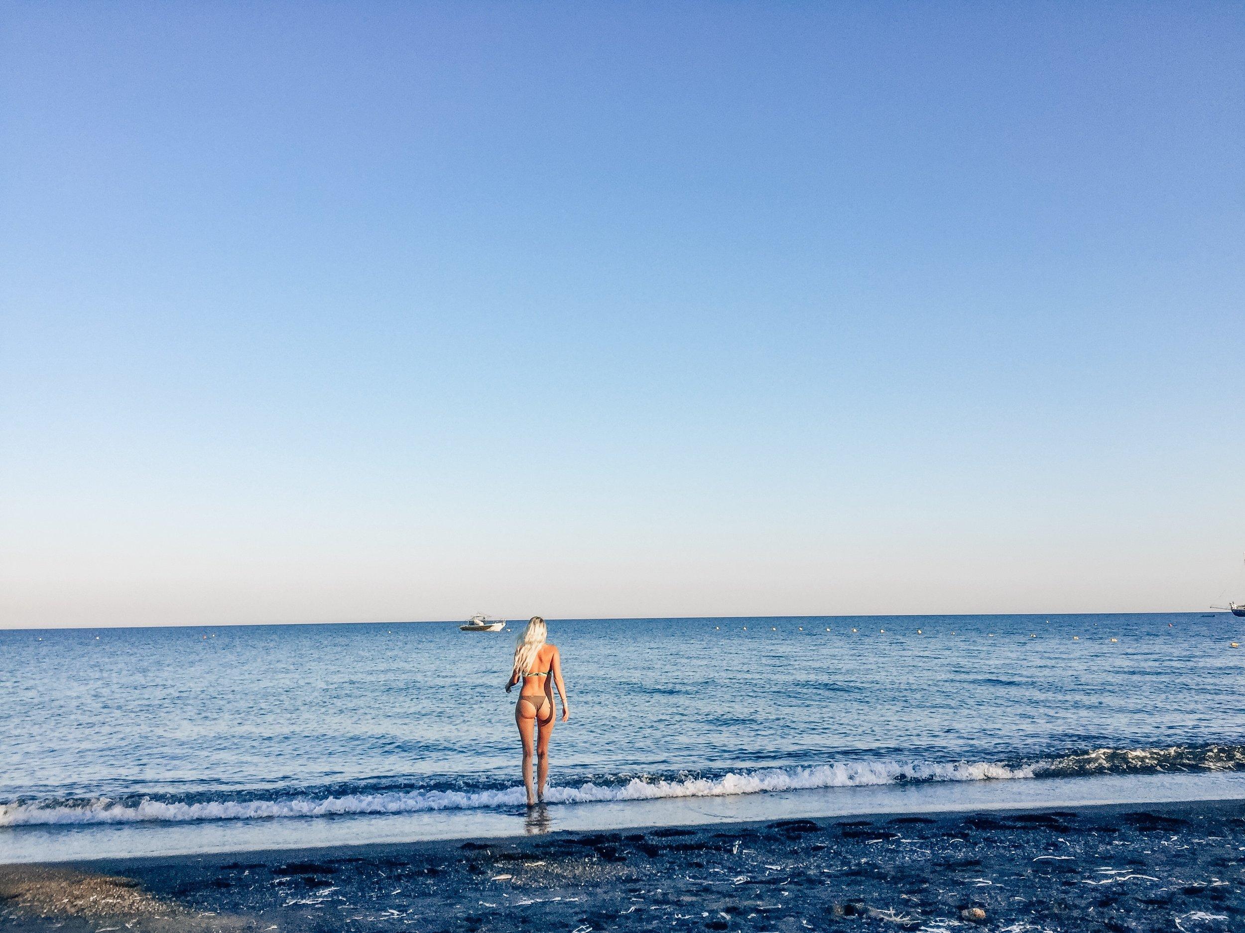 perivolos beach black sand santorini greece