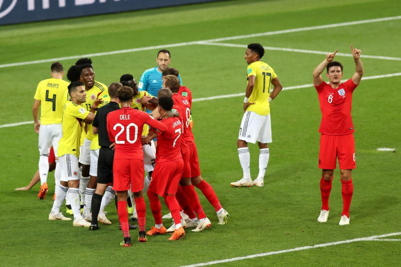 Alex Morton/Getty Images    - England's Harry Maguire (6) requests for VAR review