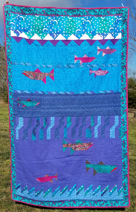 "Marla Varner pennylanequilts@gmail.com, pennylanequilts.com Salmon Seminole quilt  69' x 43""  NFS  My first quilt, created in 1993 during a class by Dorothy Hanisko, the pattern designer.   Materials: commercial cotton"