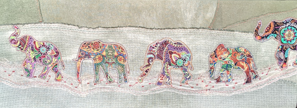 Elephant Parade   This piece was created for the children's room at a library and is hand-embroidered and made from hand-dyed silks and enhanced commercial fabric.