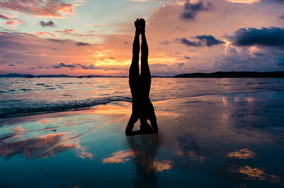 yoga-stand-in-hands-silhouette-2149407_960_720.jpg