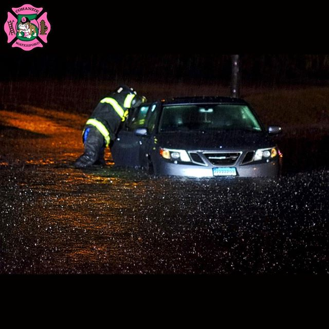 Heavy #rain bounces off the surface of the water, as Lt. Chris Myers, of the #Cohanzie #FireCompany, checks a car for additional victims, after the vehicle became stranded in a #flashflood event on Route 85, trapping its driver inside, during a violent evening #rainstorm, in #WaterfordCT, #CT. #Waterford #Firefighters responded to an additional call for a driver trapped in their vehicle by flash flood waters, on Niantic River Road, during the evening's #severeweather. www.cohanziefireco.org  #FD #VolunteerFirefighter #JobTown #Firefighting #Firefighter #Firefighters #FireDepartment #FullyInvolved #FireDept #Fireman #FireTruck #VolunteerFireDepartment #FullyInvolved #ThinRedLine #EMS #NLCT #Connecticut