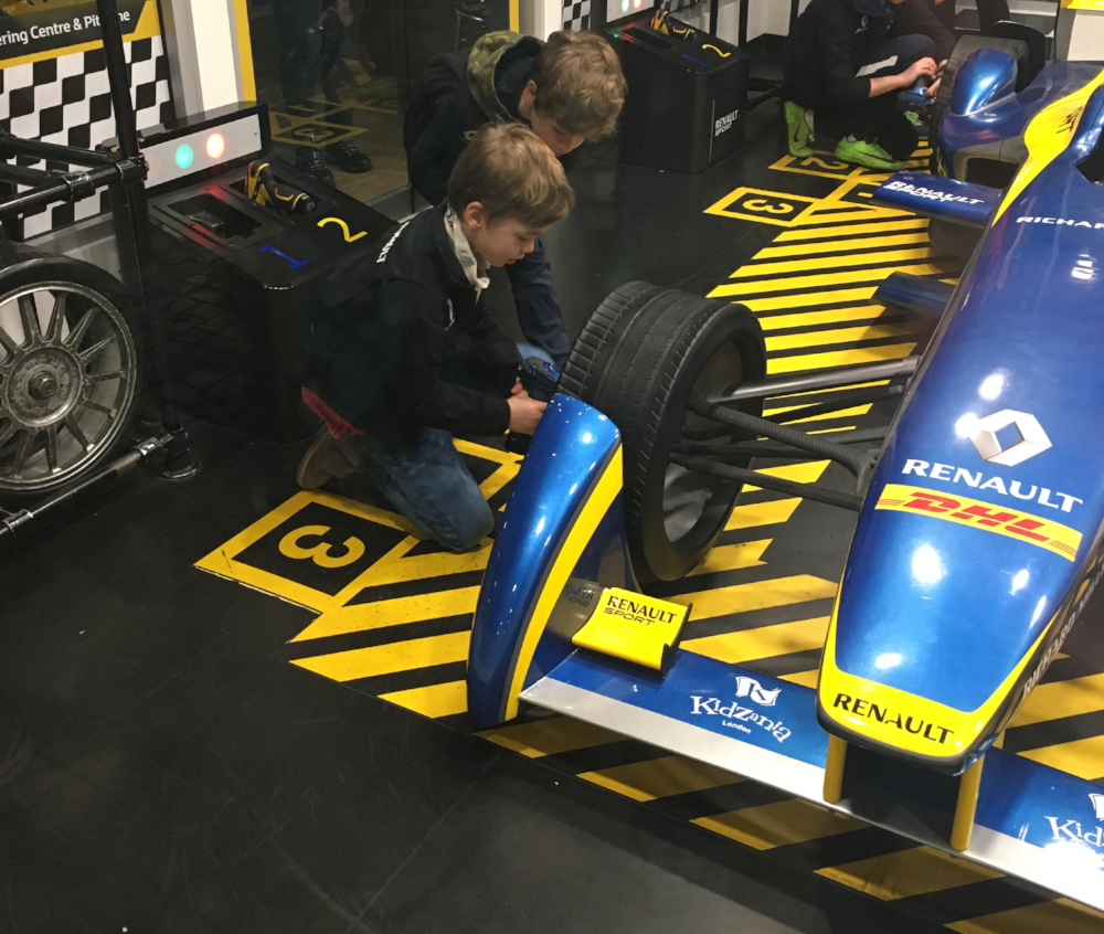 The boys change wheels in the Renault centre.