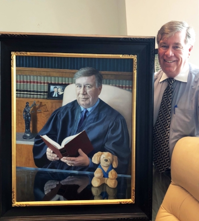 Judge Mellon believes in the Roxy Courthouse Therapy Dogs program so much that he had a Roxy Puppy included in his official portrait.