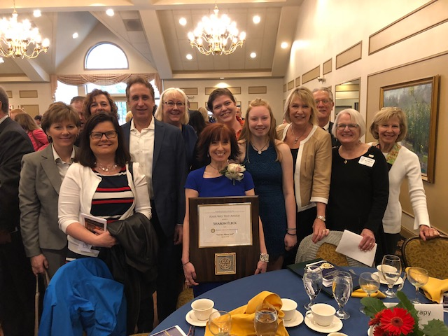 Sharon Fleck (President) with her award surrounded by Roxy volunteers