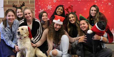 Students at Central Bucks High School East posed with Roxy therapy dogs Josie and Dizzy for a fun holiday photo.