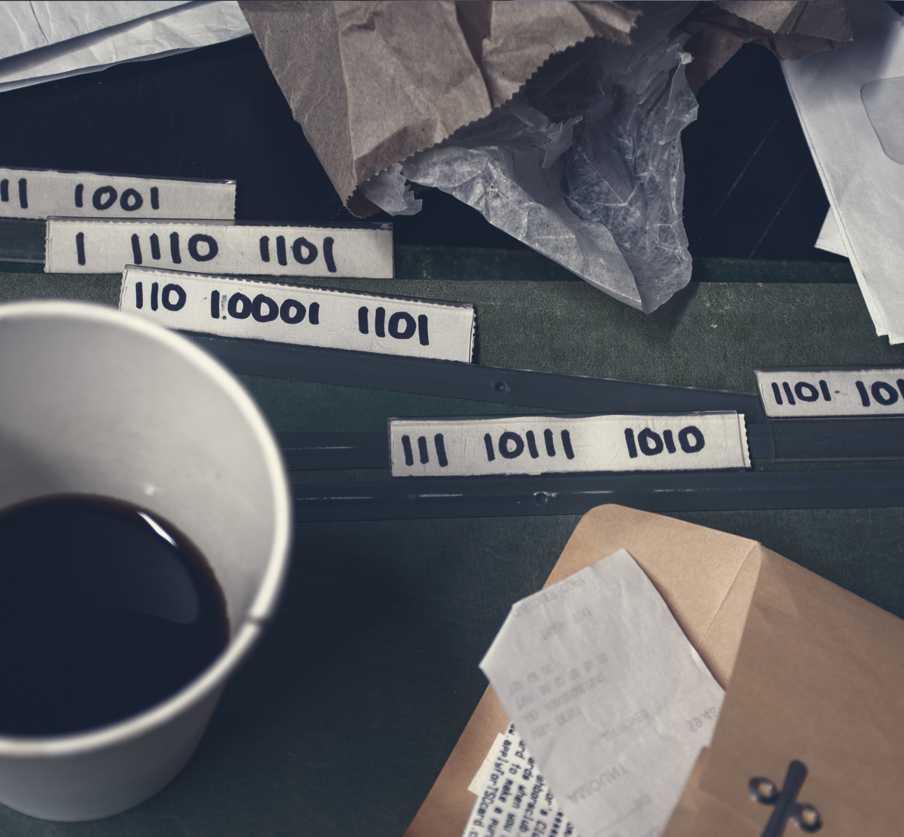"The file folder tabs read:  ""1101 10101 1100""  ""111 10111 1010""  ""110 10001 1101""  ""1 11111 1001""  ""1 1110 1101"""
