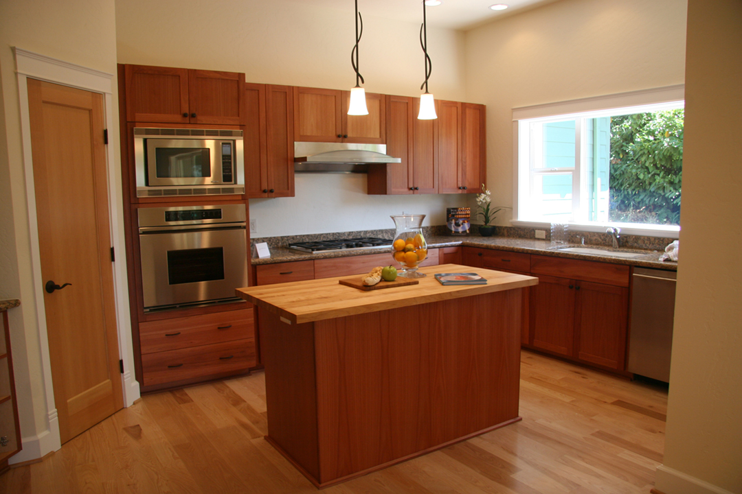 Beautiful kitchen with maple cabinets.