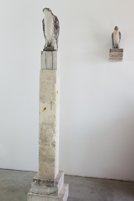 """Clock Tower,"" and ""The Bird I Saw,"" Installation, 2009 Limestone and pigment 85 x 16 x 14 inches"